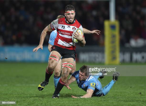 Jake Polledri of Gloucester breaks through the Irish defence to score a try during the Aviva Premiership match between Gloucester Rugby and London...