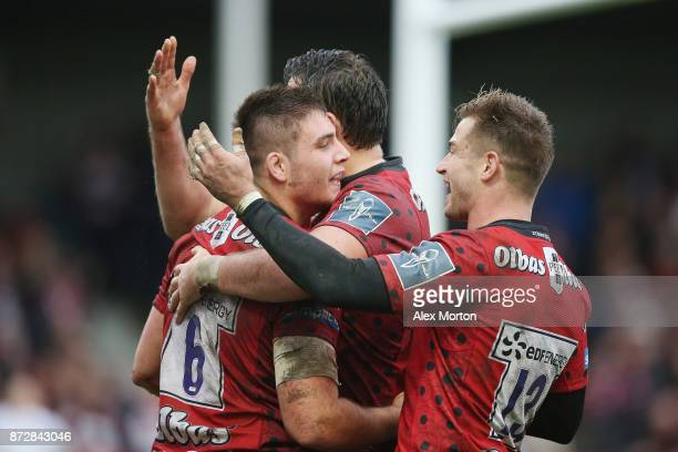 Jake Polledri of Gloucester celebrates with teammates after scoring a try during the AngloWelsh Cup match between Gloucester Rugby and London Irish...