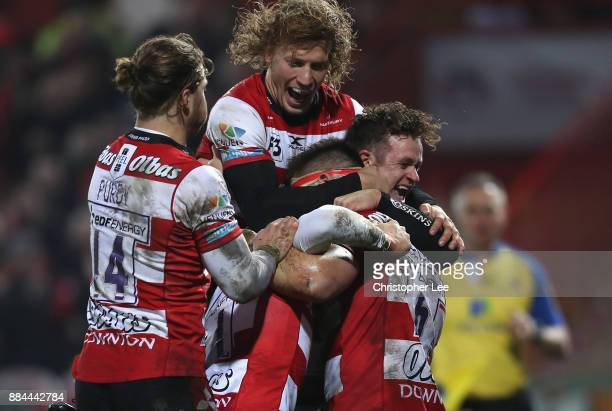Jake Polledri of Gloucester is mobbed by his team mates after scoring a try during the Aviva Premiership match between Gloucester Rugby and London...