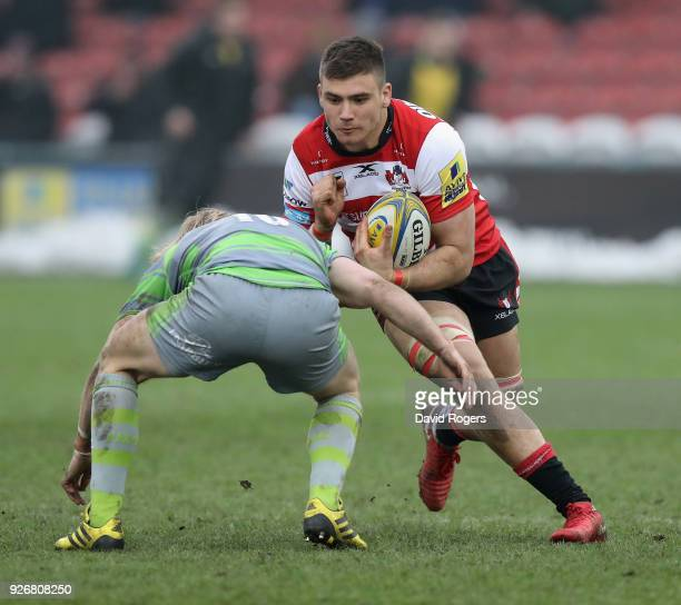 Jake Polledri of Gloucester is tackled by Joel Hodgson during the Aviva Premiership match between Gloucester Rugby and Newcastle Falcons at Kingsholm...