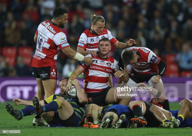 Jake Polledri of Gloucester Rugby is congratulated by teammates after winning the ball during the European Rugby Challenge Cup Final match between...
