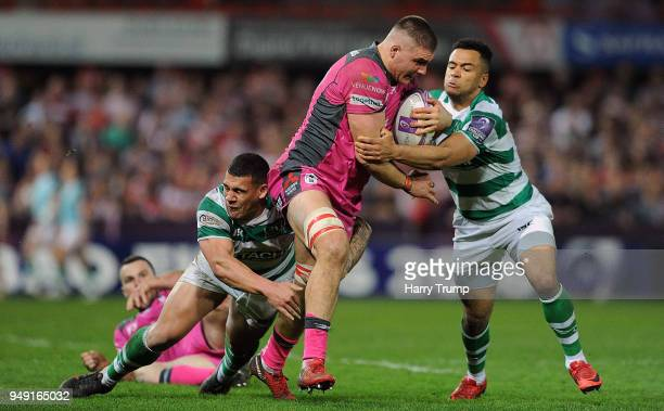 Jake Polledri of Gloucester Rugby is tackled by Zach Kibiridge of Newcastle Falcons during the European Challenge Cup SemiFinal match between...