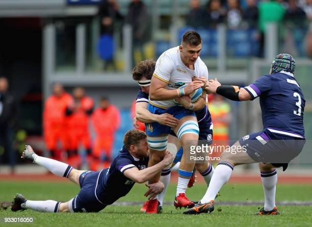 Jake Polledri of Italy is tackled by Scotland players during the NatWest Six Nations match between Italy and Scotland at Stadio Olimpico on March 17...