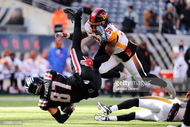 Jake Powell of the NY Guardians is tackled by Gause Quentin of the LA Wildcats during the first half of their XFL game at MetLife Stadium on February...