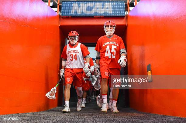 Jake Pulver and Clarke Petterson of the Cornell Big Red lead their teammates to the field prior to the game against the Syracuse Orange in a 2018...
