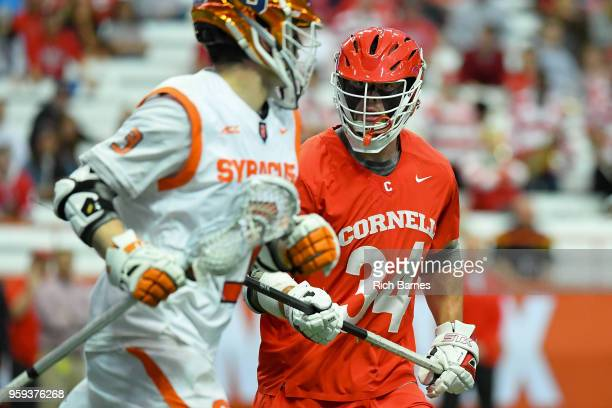 Jake Pulver of the Cornell Big Red defends Nate Solomon of the Syracuse Orange during a 2018 NCAA Division I Men's Lacrosse Championship First Round...