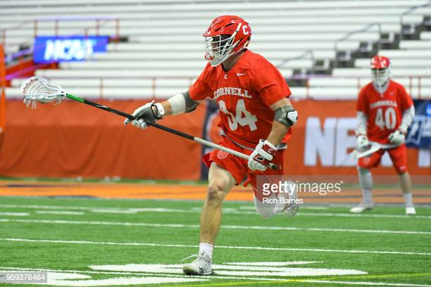 Jake Pulver of the Cornell Big Red runs with the ball against the Syracuse Orange during a 2018 NCAA Division I Men's Lacrosse Championship First...