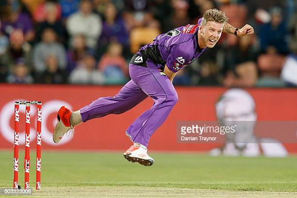 Jake Reed of the Hobart Hurricanes bowls during the Big Bash League match between the Hobart Hurricanes and the Melbourne Renegades at Blundstone...