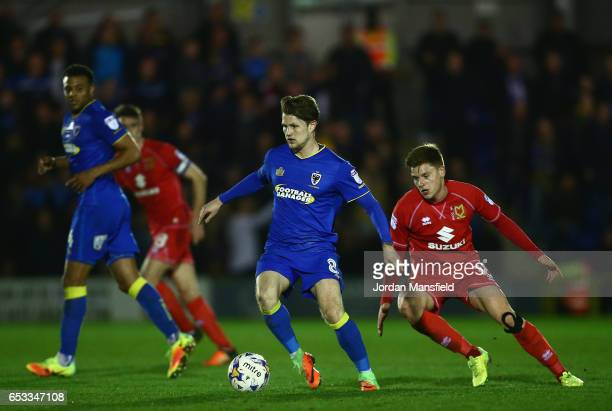 Jake Reeves of AFC Wimbledon is closely watched by Harvey Barnes of Milton Keynes Dons during the Sky Bet League One match between AFC Wimbledon and...