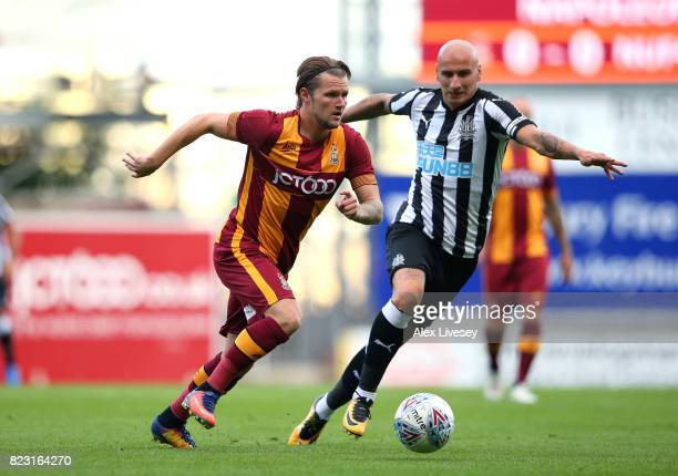 Jake Reeves of Bradford City beats Jonjo Shelvey of Newcastle United during a preseason friendly match between Bradford City and Newcastle United at...