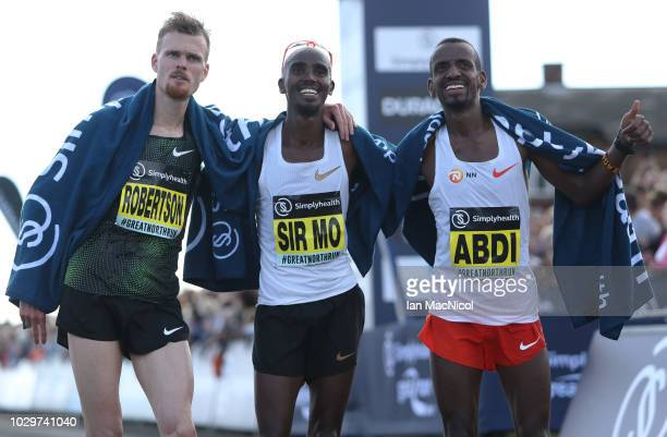 Jake Robertson Mo Farah and Bashir Abdi are seen after the Elite Men's Race during The Great North Run on September 9 2018 in Newcastle upon Tyne...
