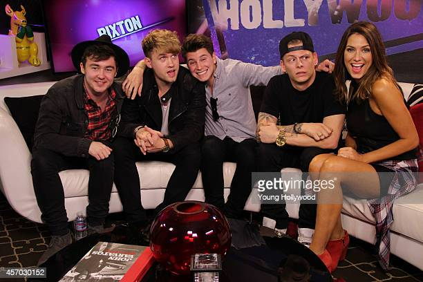 Jake Roche Danny Wilkin Charley Bagnall Lewi Morgan from the band Rixton and host Nikki Novak at the Young Hollywood Studio on October 10 2014 in Los...