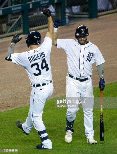 Jake Rogers of the Detroit Tigers celebrates his home run against the Chicago Cubs with Robbie Grossman during the sixth inning at Comerica Park on...