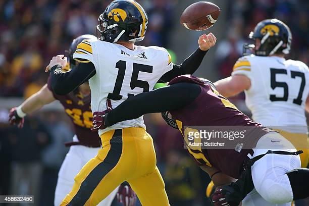 Jake Rudock of the Iowa Hawkeyes gets hit and fumbles the ball by Steven Richardson of the Minnesota Golden Gophers during the second quarter on...