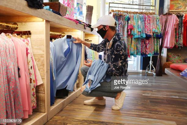 Jake Sanders works at the Tommy Bahamas store, as the state of Florida enters phase one of the plan to reopen the state on May 04, 2020 in Stuart,...