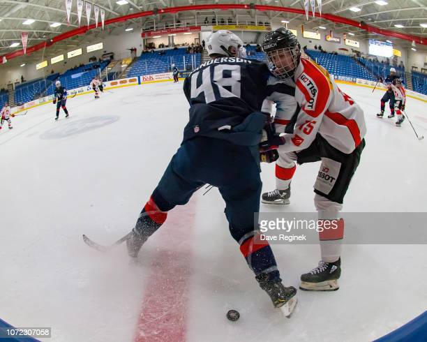 Jake Sanderson of the US Nationals battles for the puck in the second period with Christophe Cavalleri of the Switzerland Nationals during day2 of...
