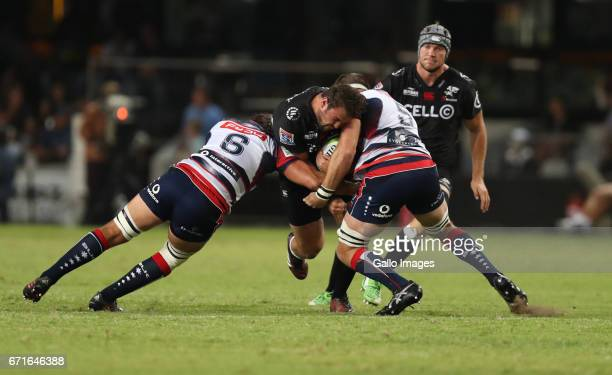Jake Schatz and Steve Cummins of the Melbourne Rebels with a tackle on Franco Marais of the Cell C Sharks during the Super Rugby match between Cell C...