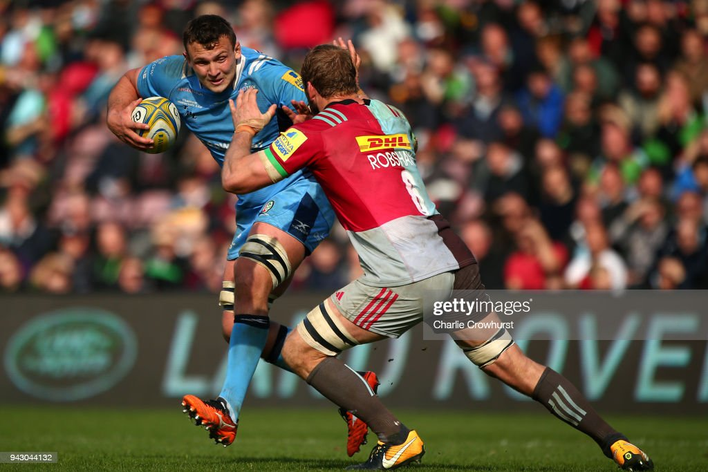 Jake Schatz of London Irish looks to hold off the tackle from Chris Robshaw of Harlequins during the Aviva Premiership match between Harlequins and London Irish at Twickenham Stoop on April 7, 2018 in London, England.