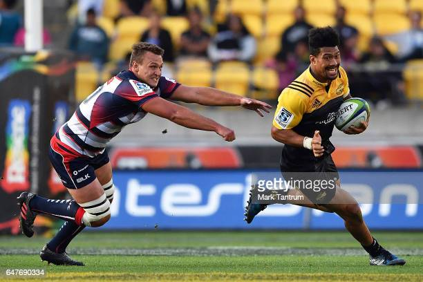 Jake Schatz of the Melbourne Rebels and Ardie Savea of the Hurricanes during the round two Super Rugby match between the Hurricanes and the Rebels at...