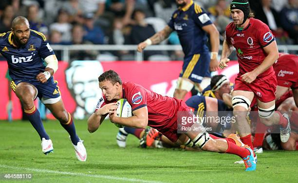 Jake Schatz of the Reds scores a try during the round three Super Rugby match between the Highlanders and the Reds at Forsyth Barr Stadium on...