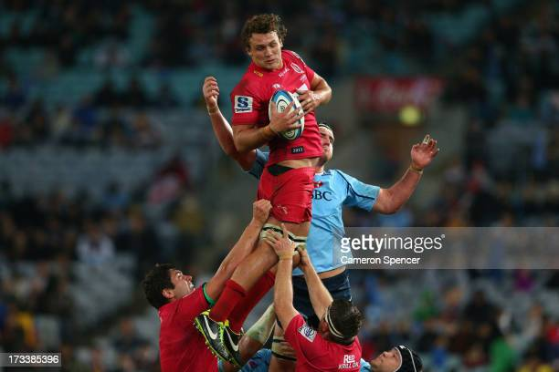 Jake Schatz of the Reds takes a lineout ball during the round 20 Super Rugby match between the Waratahs and the Reds at ANZ Stadium on July 13, 2013...