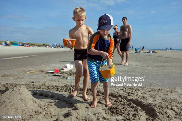 Jake Schoen of Arlington Mass left and his cousin Mason Price of Chicago decide where to put their next buckets of sand during the sand castle...