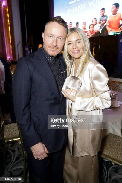 Jake Scott and honoree Sienna Miller attend the International Medical Corps Annual Awards Celebration at The Beverly Wilshire on November 07 2019 in...