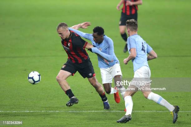 Jake Scrimshaw of Bournemouth holds off Jeremie Frimpong of Manchester City during the FA Youth Cup match between AFC Bournemouth U18 and Manchester...