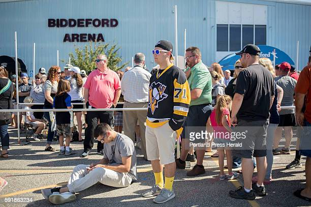 Jake Segal center from Windham waits in line outside of the Biddeford Arena for a chance to see the Stanley Cup up close and personal Brian Dumoulin...