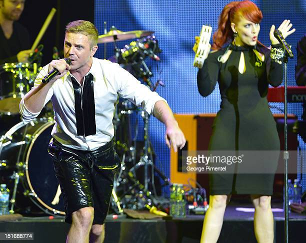 Jake Shears and Ana Matronic of Scissor Sisters perform at Fashion Cares A Night Of Glitter Light Featuring Elton John Show at Sony Centre For...