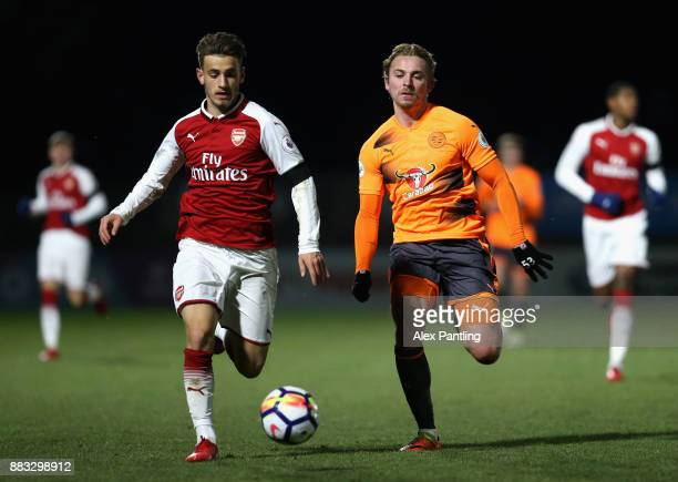 Jake Sheppard of Reading and Vlad Dragomir of Arsenal battle for the ball during the Premier League International Cup match between Arsenal and...