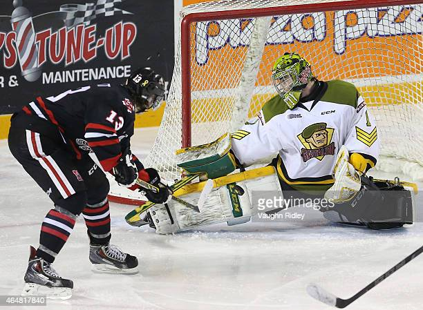 Jake Smith of the North Bay Battalion makes a save on Graham Knott of the Niagara IceDogs during an OHL game at the Meridian Centre on February 28...