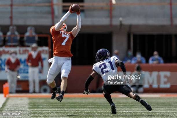 Jake Smith of the Texas Longhorns catches a pass defended by Noah Daniels of the TCU Horned Frogs in the first half at Darrell K Royal-Texas Memorial...