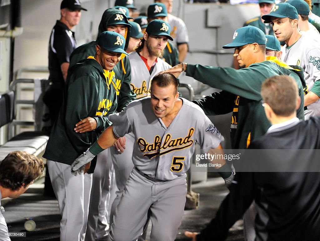 Jake Smolinski #5 of the Oakland Athletics is greeted by teammates after hitting a home run against the Chicago White Sox during the third inning on September 14, 2015 at U.S. Cellular Field in Chicago, Illinois.