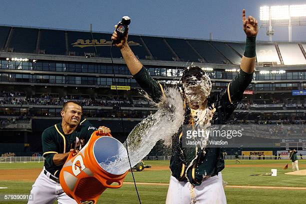 Jake Smolinski of the Oakland Athletics pours water on Ryon Healy after the game against the Tampa Bay Rays at the Oakland Coliseum on July 23 2016...