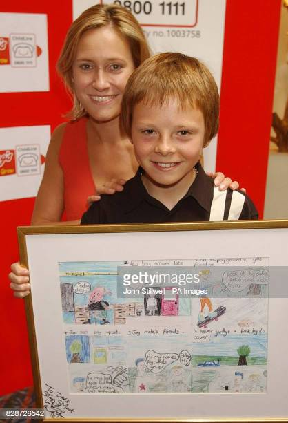 Jake South from Calne Wiltshire with BBC TV news presenter Sophie Raworth and his award winning cartoon which he entered in the Childline Cartoon...