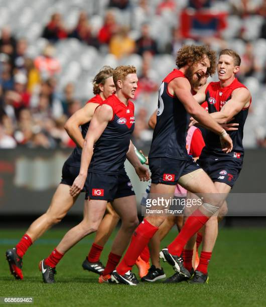 Jake Spencer of the Demons celebrates a goal during the round four AFL match between the Melbourne Demons and the Fremantle Dockers at Melbourne...