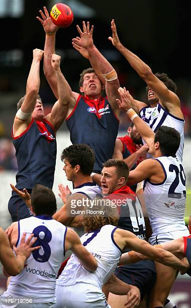 Jake Spencer of the Demons marks during the round 21 AFL match between the Melbourne Demons and the Fremantle Dockers at Melbourne Cricket Ground on...
