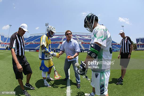 Jake Steinfeld the founder of Major League Lacrosse performs a ceremonial faceoff with Chris Mattes of the Florida Launch and Stephen Robarge of the...