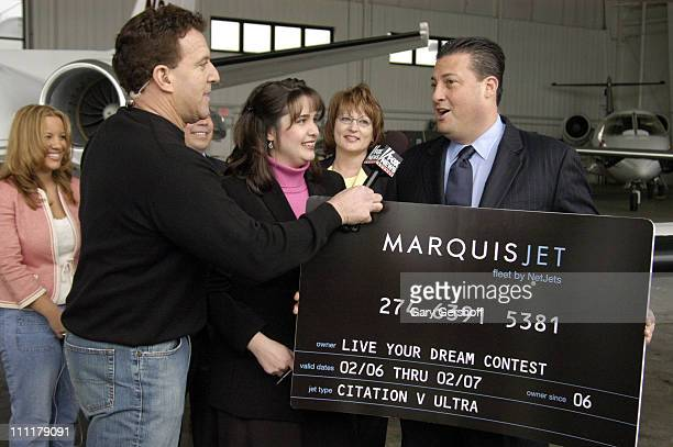 Jake Steinfeld with winner Jennifer Tuttle and Kenny Dichter CEO and founder of Marquis Jet