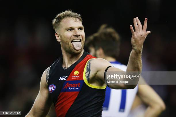 Jake Stringer of Essendon celebrates a goal as he shows his coloured fingernails during the round 17 AFL match between the Essendon Bombers and the...