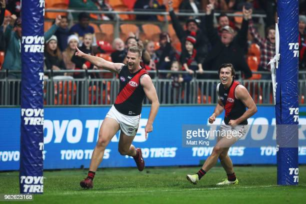Jake Stringer of the Bombers celebrates a goal during the round 10 AFL match between the Greater Western Sydney Giants and the Essendon Bombers at...