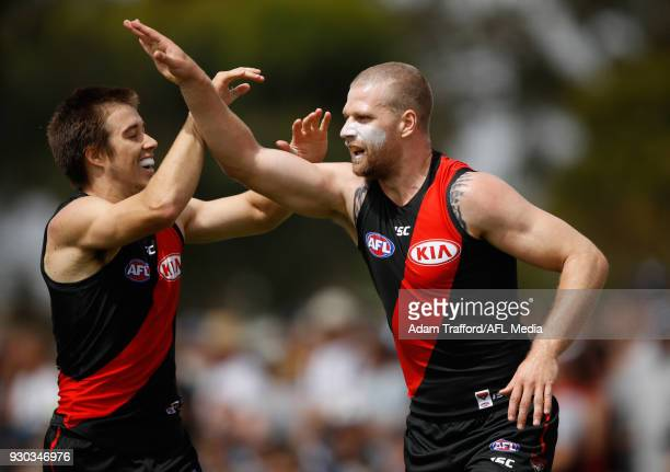 Jake Stringer of the Bombers celebrates a goal with Zach Merrett of the Bombers during the AFL 2018 JLT Community Series match between the Geelong...
