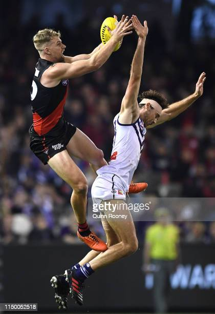 Jake Stringer of the Bombers marks over Joel Hamling of the Dockers during the round nine AFL match between the Essendon Bombers and the Fremantle...