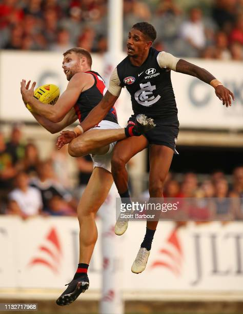 Jake Stringer of the Bombers marks the ball ahead of Jarrod Garlett of the Blues during the 2019 JLT Community Series AFL match between the Carlton...