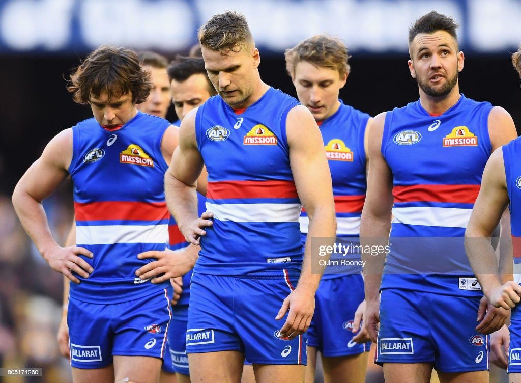Jake Stringer of the Bulldogs and his team mates look dejected after losing the round 15 AFL match between the Western Bulldogs and the West Coast Eagles at Etihad Stadium on July 1, 2017 in Melbourne, Australia.