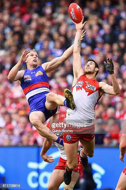 Jake Stringer of the Bulldogs attempts to mark over the top of Sam Naismith of the Swans during the 2016 AFL Grand Final match between the Sydney...