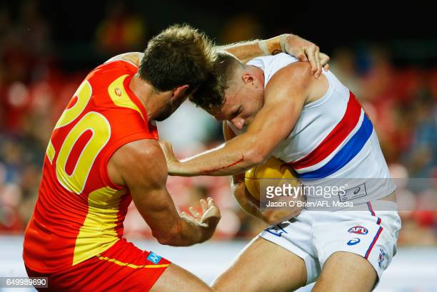 Jake Stringer of the Bulldogs is tackled by Kade Kolodjashnij of the suns during the JLTR Community Series AFL match between the Gold Coast Suns and...