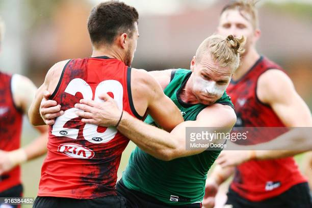 Jake Stringer tackles Jackson Merrett during the Essendon Bombers AFL IntraClub Match at The Hangar on February 10 2018 in Melbourne Australia