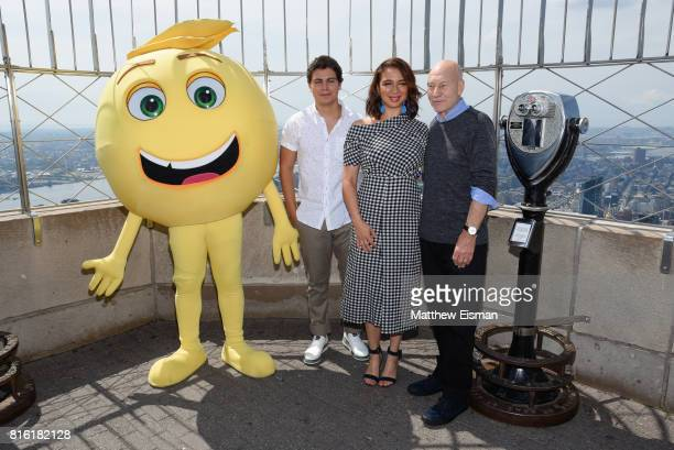 Jake T Austin Maya Rudolph and Sir Patrick Stewart of the film The Emoji Movie pose together for a photo to celebrate World Emoji Day at The Empire...